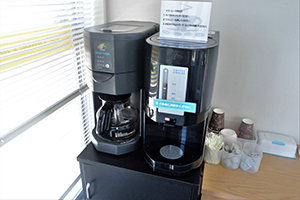 There is a free coffee dispenser available.