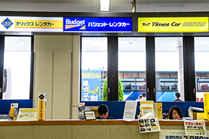 Please check-in at the airport counter OR call the office and ask for the pick-up service.